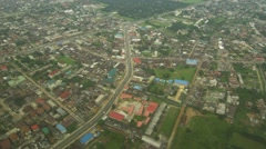 Helicopter shot of building and riverine in port harcourt Stock Footage