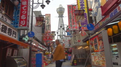 Timelapse Tsutenkaku tower and commercial road neon sign Osaka city day iconic Stock Footage