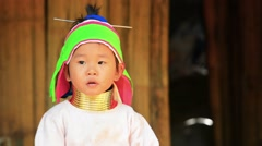 CHIANG RAI, THAILAND - CIRCA DEC 2013: Young Padaung Girl Wearing Traditional Stock Footage