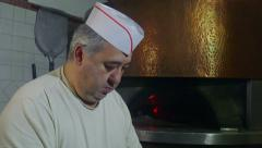 Man At Work Chef Making Pizza In Italian Restaurant Kitchen Stock Footage