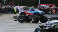 Monster truck huge wheels crashing junk cars, entertaining crowd HD Footage