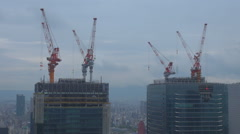 Timelapse crane machine work Osaka built tall tower property workplace day icon Stock Footage