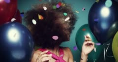 Beautiful young hispanic woman dancing celebrating birthday multicolored balloon - stock footage