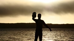 Silhouette of sporting man lifting weight 3 Stock Footage
