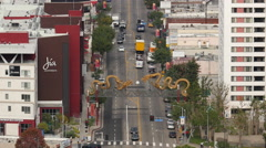 Zoom Out / View of Traffic in Chinatown  in Downtown Los Angeles California Stock Footage