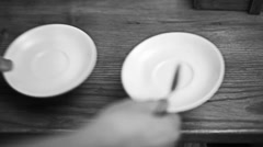 Barista raises two saucers and two tablespoons of coffee Stock Footage
