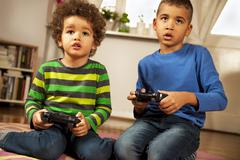 Two Friends Playing Video Game Stock Photos