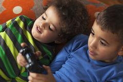 Two Friends Playing Video Game - stock photo