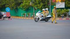 Police officer directing traffic on a typical intersection in Vientiane, Laos Stock Footage