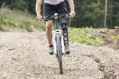 Handicapped mountain bike rider track Stock Photos