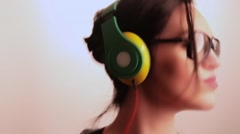 Young woman with vintage Black Framed glasses listens to music through her DJ St Stock Footage