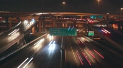 Night Time-lapse traffic at major highway intersection Stock Footage