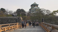 Tourist people visit Osaka Castle traditional building landmark iconic icon day Stock Footage