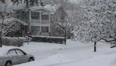 Snow falling in neighborhood - stock footage
