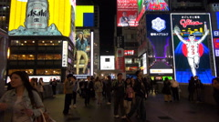 Timelapse Osaka downtown Dotonbori ad neon sign silhouette people night emblem  Stock Footage