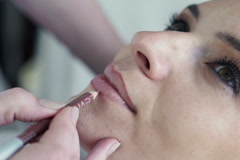 Young, beautiful woman getting permanent lips makeup at beauty salon NTSC Stock Footage
