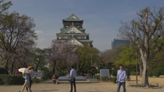 Tourist people enjoy visit Osaka Castle spring season landmark emblem iconic day Stock Footage
