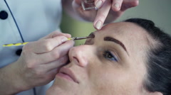 Stock Video Footage of Young woman getting eyebrow makeup at beauty salon HD