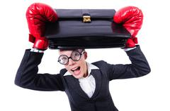 Funny businesswoman with boxing gloves Stock Photos