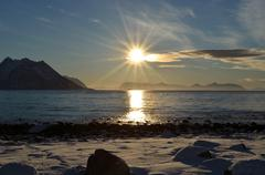 Serene ocean landscape with snowy sea shore, ocean fog and majestic mountains Kuvituskuvat