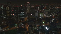 Aerial view Osaka night tall tower modern skyscraper business center cityscape  Stock Footage