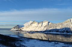 Fjord and settlement between mighty majestic mountain, senja Stock Photos
