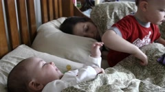 Sick mother sleeping with her kids in her bed Stock Footage