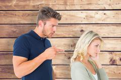 Stock Photo of Composite image of young couple having an argument