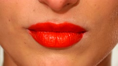 Plump sensual woman`s red lips biting, close up Stock Footage
