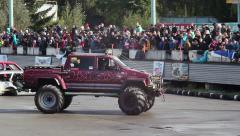 Bigfoot pulling another monster truck, sporting event, show - stock footage
