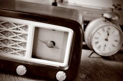 antique radio, alarm clock and typewriter, in sepia toning - stock photo