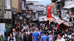 Crowd of tourists walk near the famous temple Kiyomizu in Kyoto, Japan Stock Footage