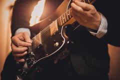 Men playing guitar no face Stock Photos