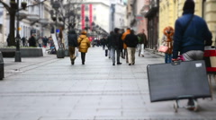 People walking at busy Shop Street on bad weather day Stock Footage