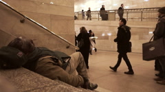 New York, NY - January 28, 2015  Homeless man on stairs Stock Footage
