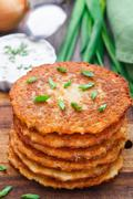 Potato pancakes on a wooden board - stock photo
