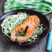 Grilled salmon with cucumber salad Stock Photos