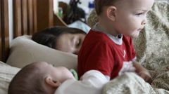 A single mother sleeping with kids in her bed Stock Footage