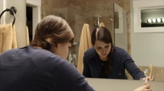 A woman brushing teeth before bedtime Stock Footage
