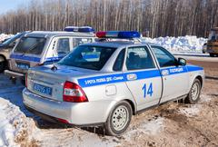 Russian patrol cars of the State Automobile Inspectorate in winter summer day Stock Photos