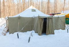 Big military tent at the winter park in sunny day - stock photo