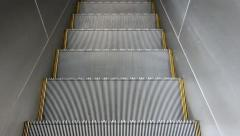 Ride the escalator down into the darkness Stock Footage