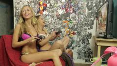Two girls play Xbox in underwear (23/23) Stock Footage