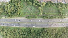Aerial view of a truck and other traffic driving along a road - stock footage
