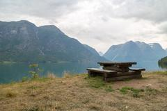 Wooden bench in fjord Stock Photos