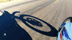 Motorcycle Front Wheel And Shadow Rolling Down Highway Stock Footage
