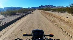 POV Motorcycle Speeding Down Desert Dirt Road- Fast Motion - stock footage
