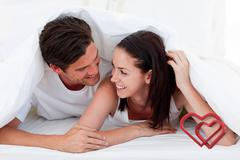 Composite image of couple talking together and lying on bed Stock Illustration