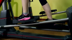 Girl doing an exercise on fitness track in the gym, slow motion Stock Footage