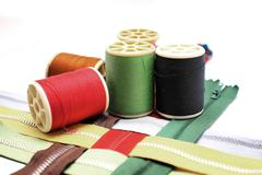 sewing buttons and zipper - stock photo